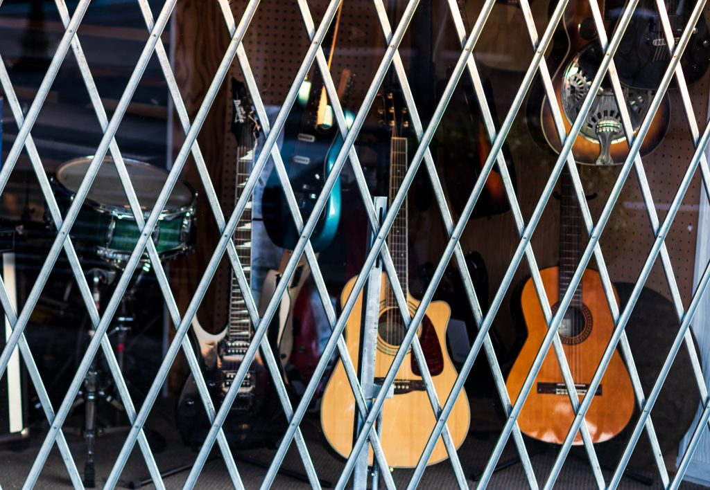 Pawn shop window covered by bars