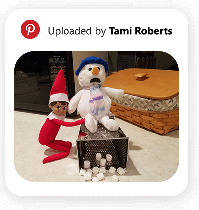 Elf making marshmallows with a snowman